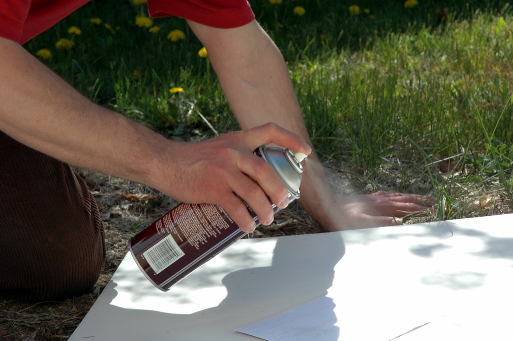 Cosplayer using spray adhesive on cardboard