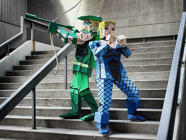 Two cosplayers in cardboard box costumes