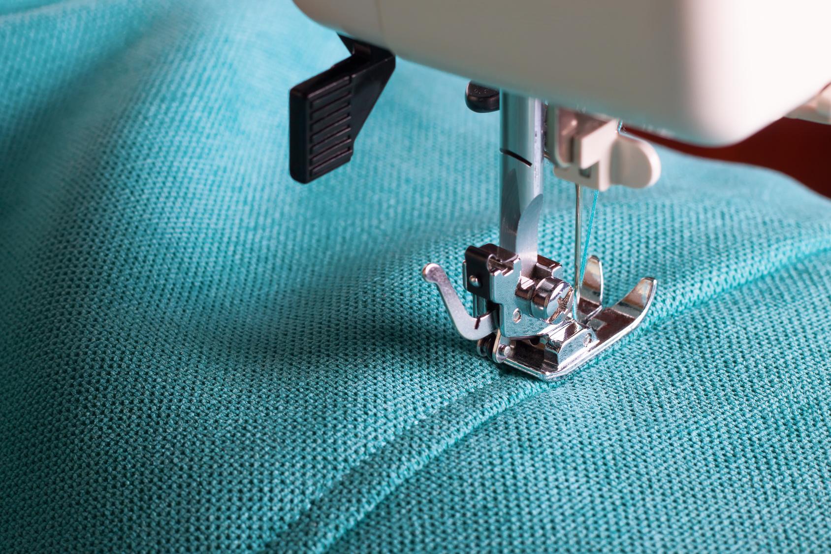 Sewing machine stitching a seam in a light blue cosplay fabric