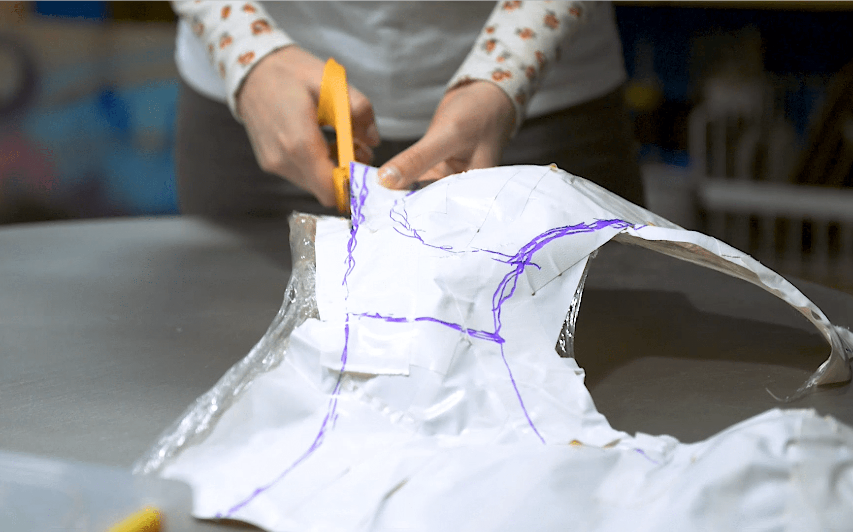 Cutting apart duct tape and plastic wrap cosplay armor pattern