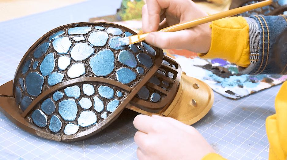 Painting metallic scales on foam dragon armor using acrylic paints
