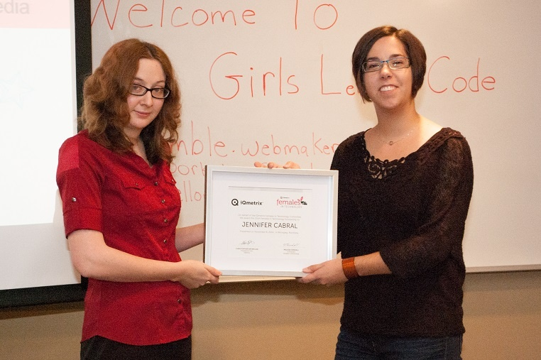 iQmetrix FIT representative Melissa Kendall presents the 2014 FIT Scholarship to Jennifer Cabral