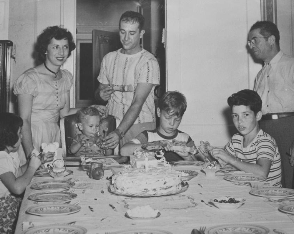 "[Gerry's 1st birthday, surrounded by his parents, his ""Nonno"" and 3 of his cousins.]"