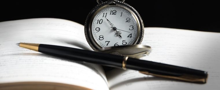 Book pen and clock