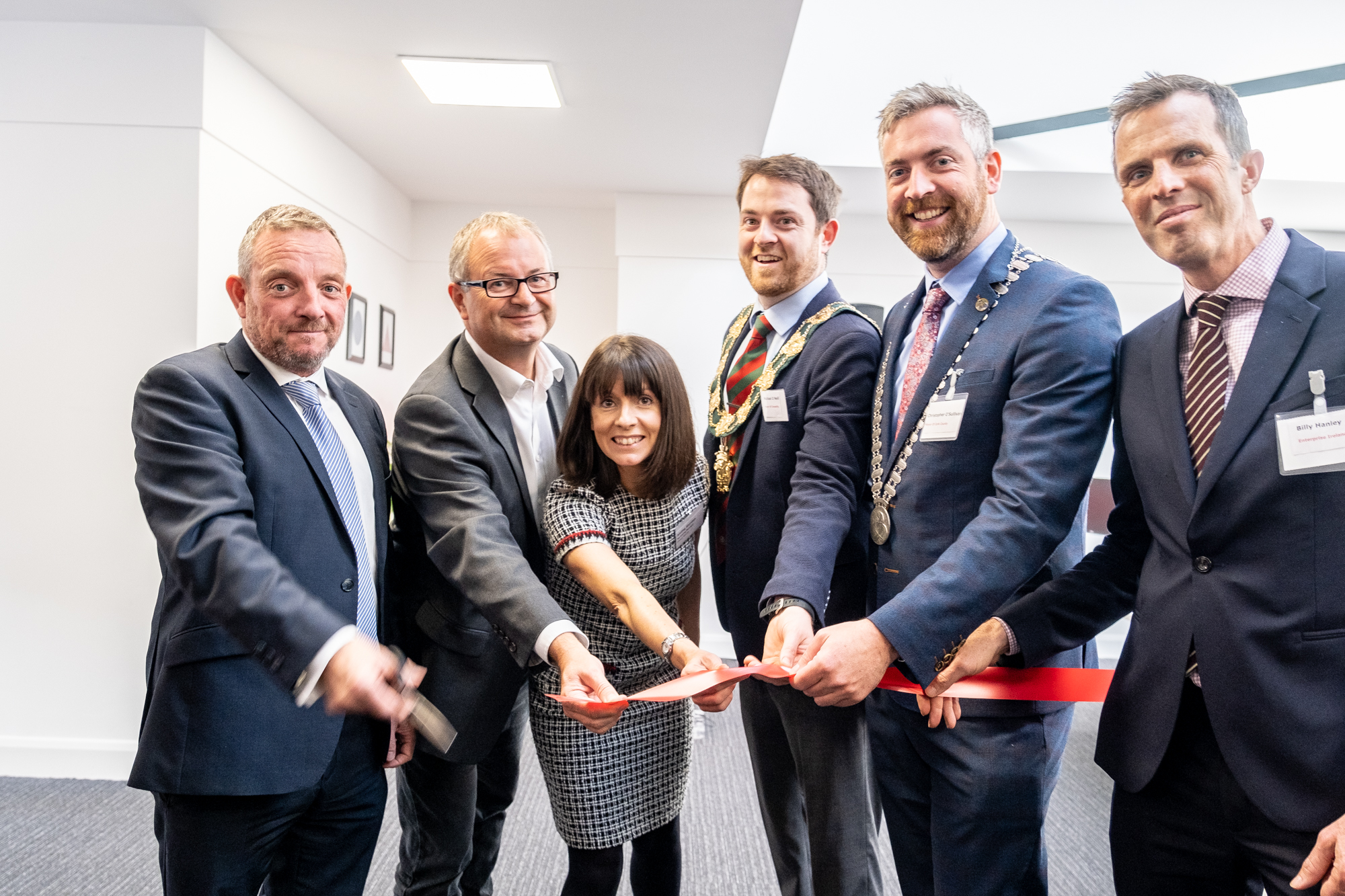 Photo of Global Shares Team cutting the red ribbon for the inauguration