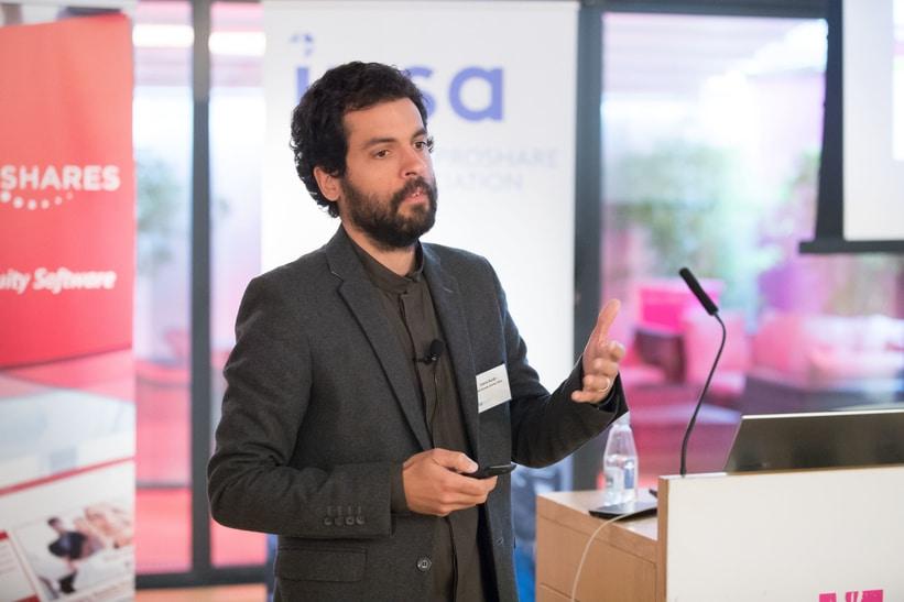 Photo of Dr Gabriel Burdin giving a speech