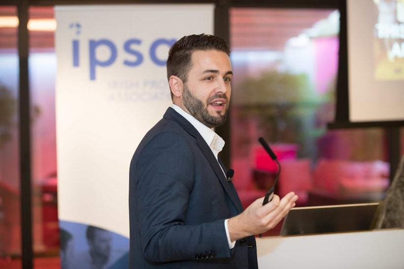 Photo of Dallan Guzinski, Director of Workplace Development giving a lecture