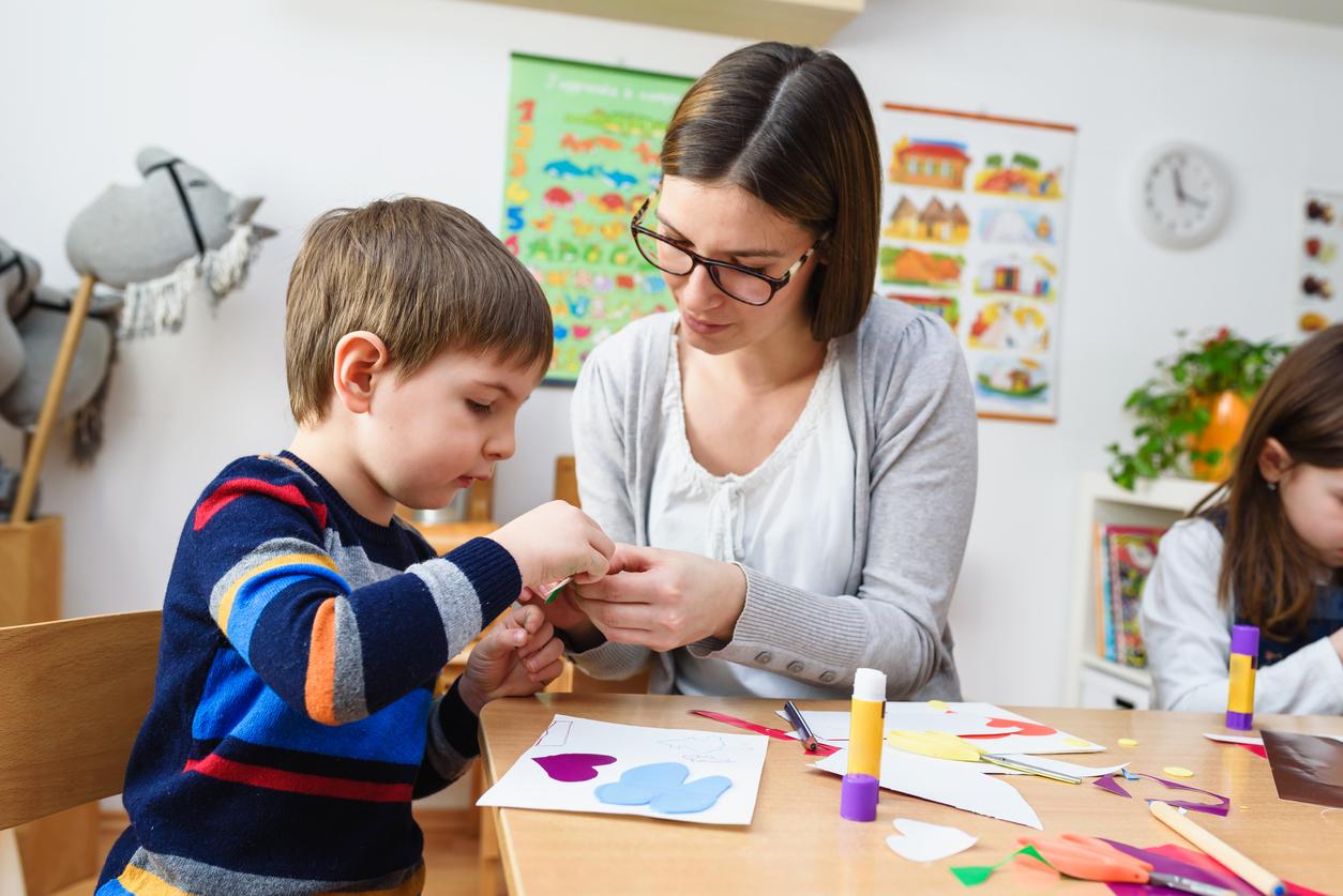 Preschool teacher with students
