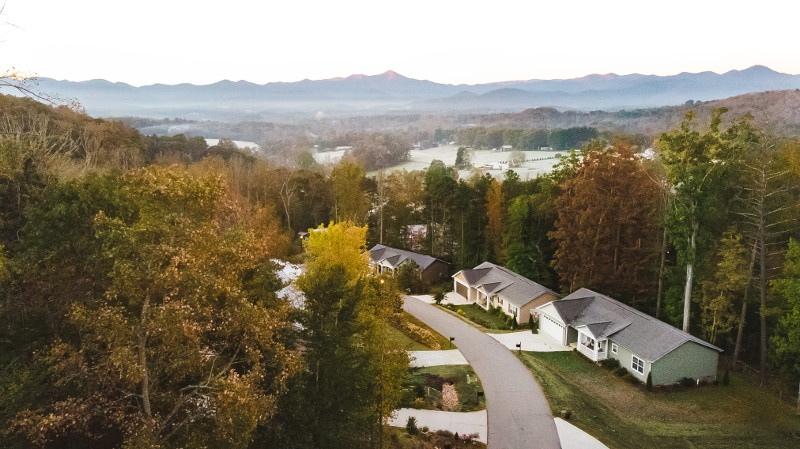 Fall mountain view aerial shot overlooking a modular home neighborhood.