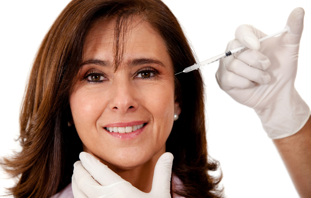 Woman getting a face lift with Botox - isolated over a white background-1