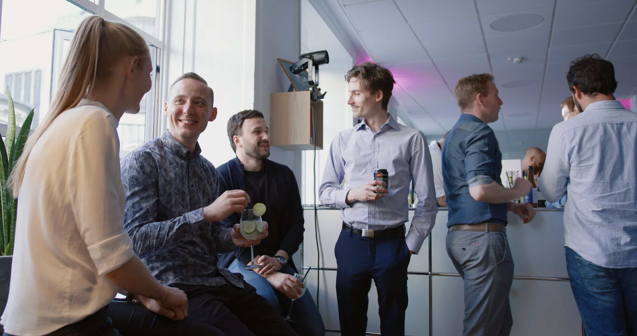 Employees at Templafy holding a drink at the office party