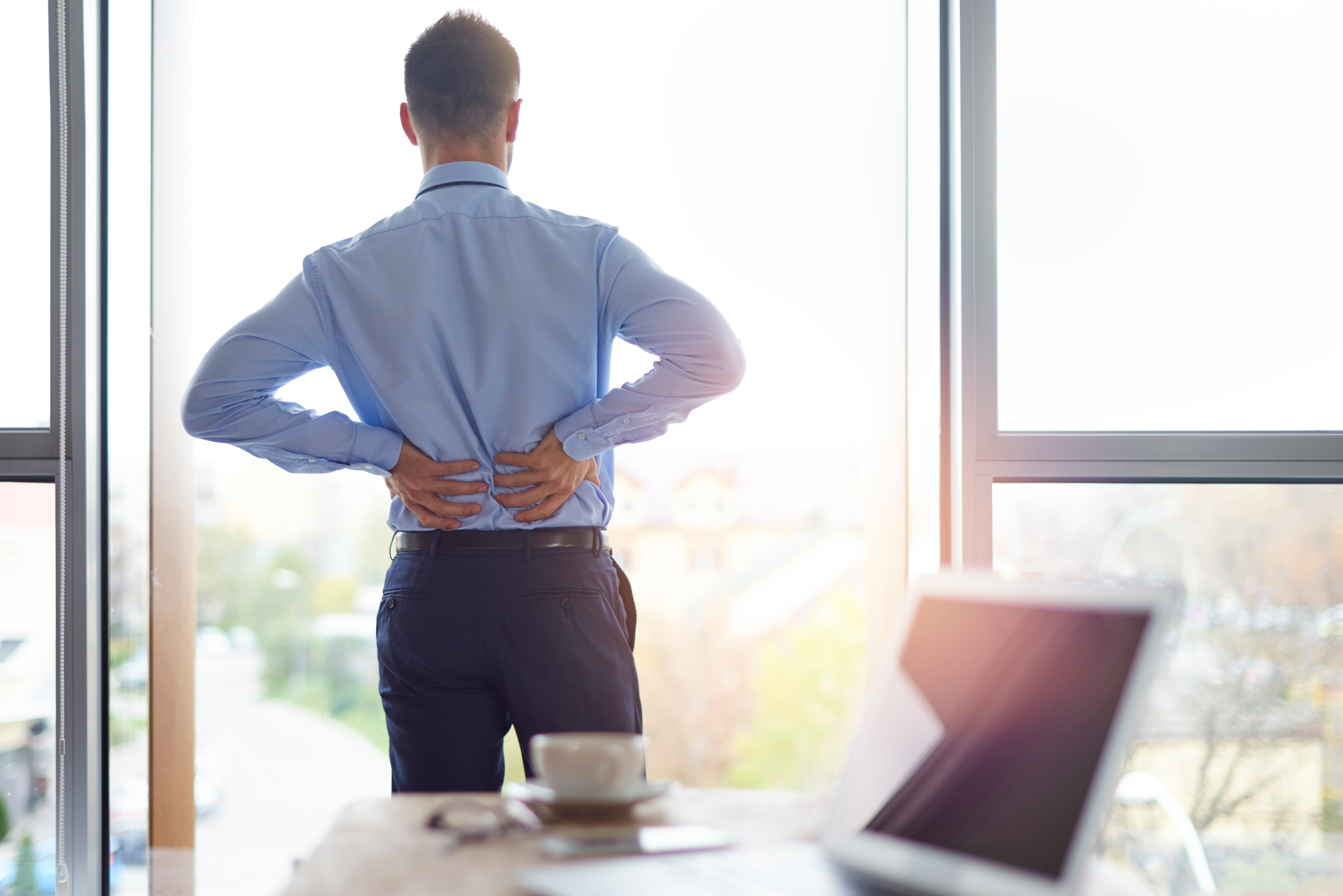 back-pain-of-business-person-RN98HK3