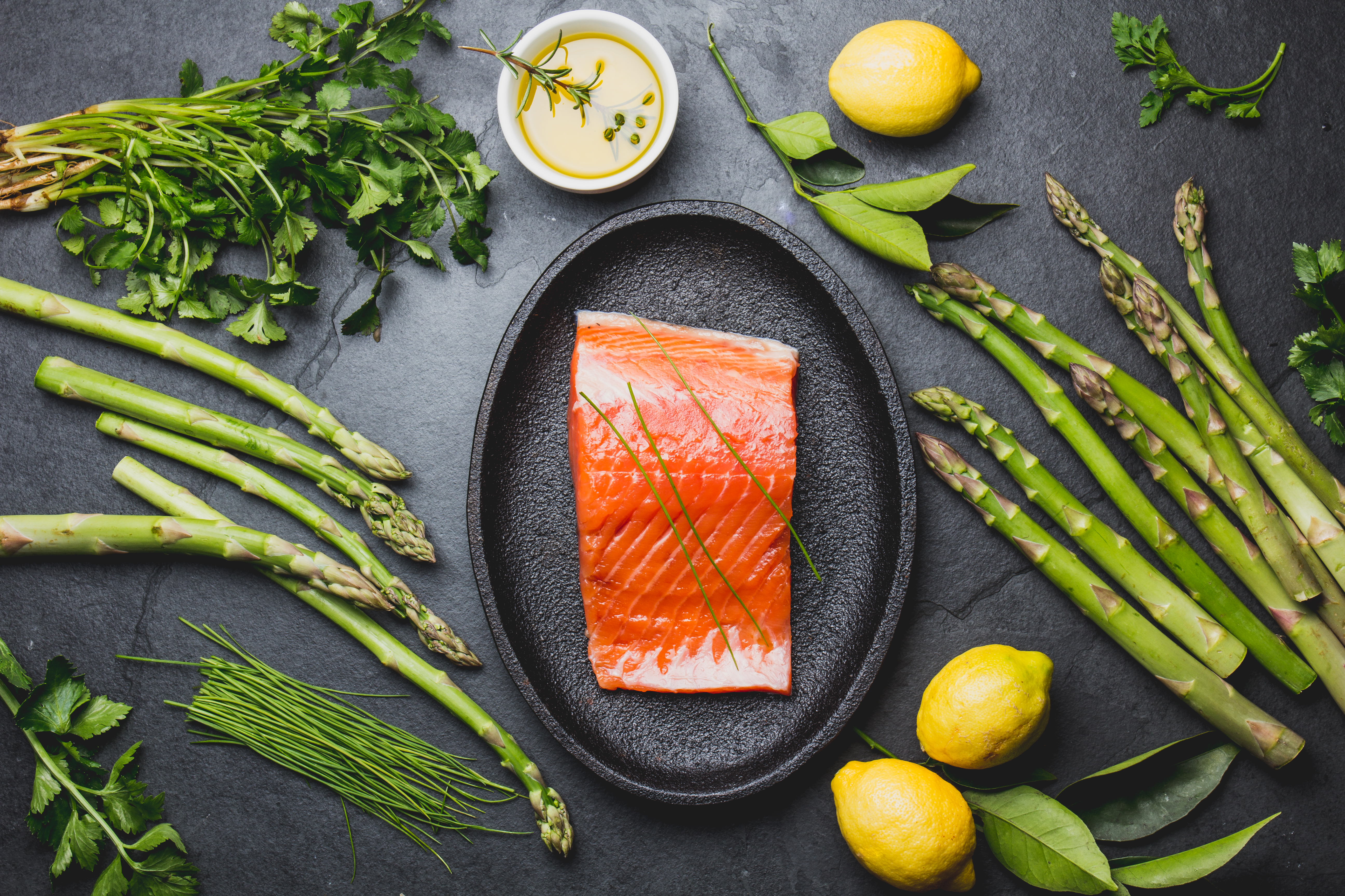 ingredients-for-cooking-salmon-asparagus-herbs-SP4NKHM (1)