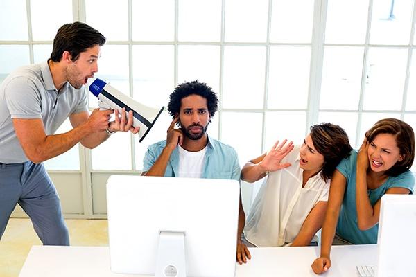 Man-yelling-through-a-megaphon.jpg
