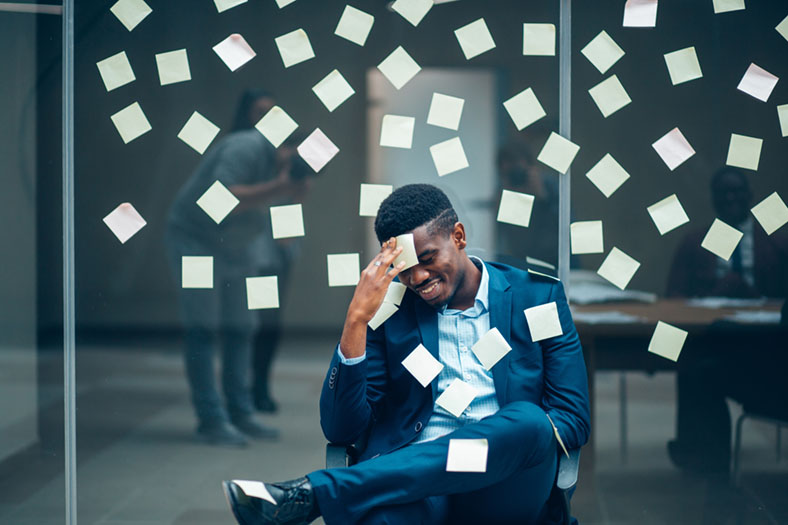 Forgetful man with sticky notes