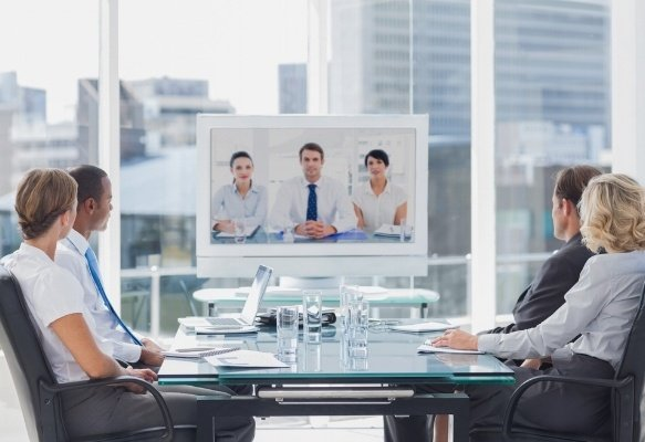 Business team having video conference with another business team in office-447977-edited.jpeg