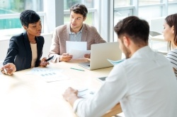 graphicstock-multiethnic-group-of-young-businesspeople-working-together-on-business-meeting-in-conference-room_r_fwTfQB2l-528196-edited.jpg