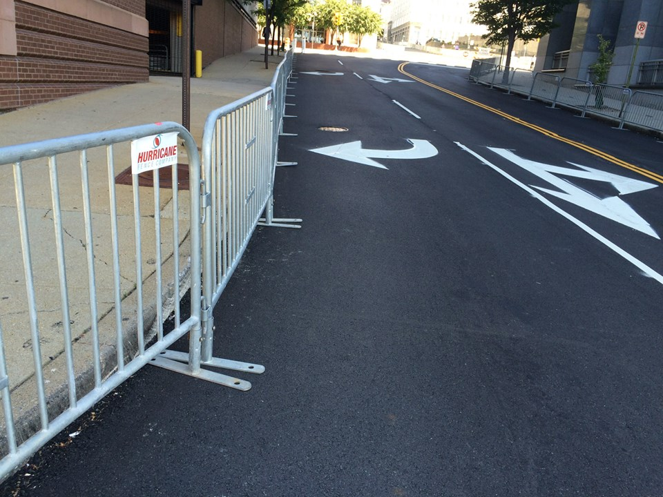 Bike racks with the Hurricane logo curve around the VA Governors mansion in prepeation for the UCI Bike Race.