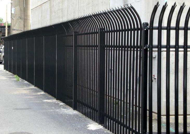 The James River Water Treatment pump in Shockoe Bottom Richmond is enclosed by 12 ft. curved spiked picket black steel