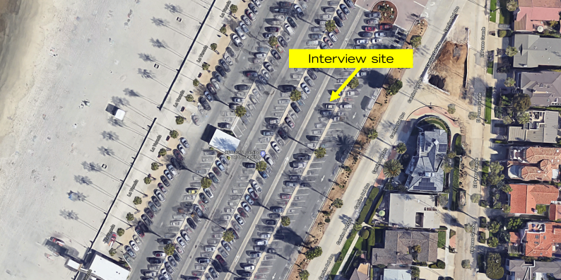 Image of the interview site in the middle of a parking lot.