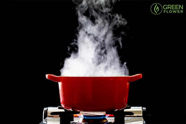 red pot boiling on a gas burner