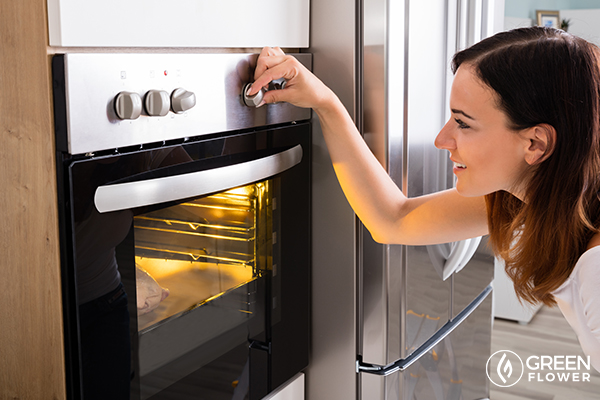 woman decarboxylating cannabis in an oven
