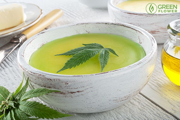 colling cannabis butter in a bowl with a pot leaf