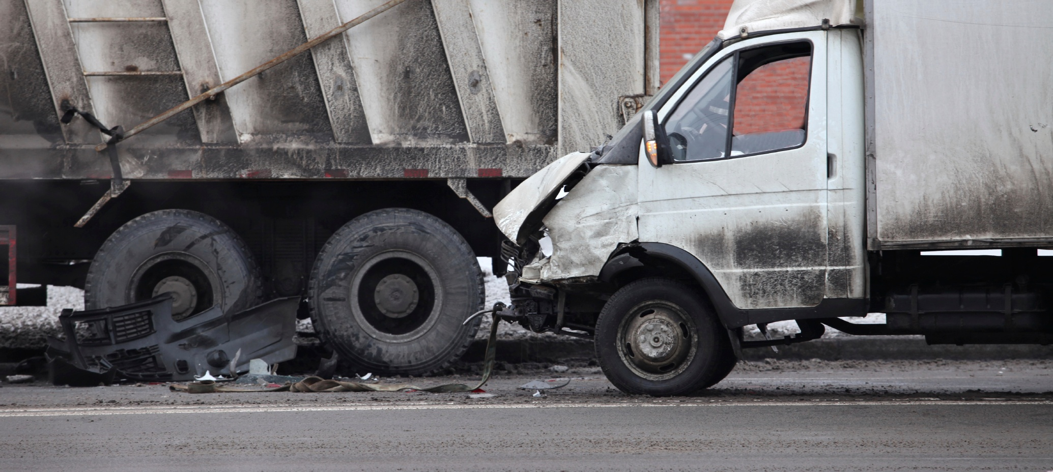 Truck getting rear-ended by a box truck