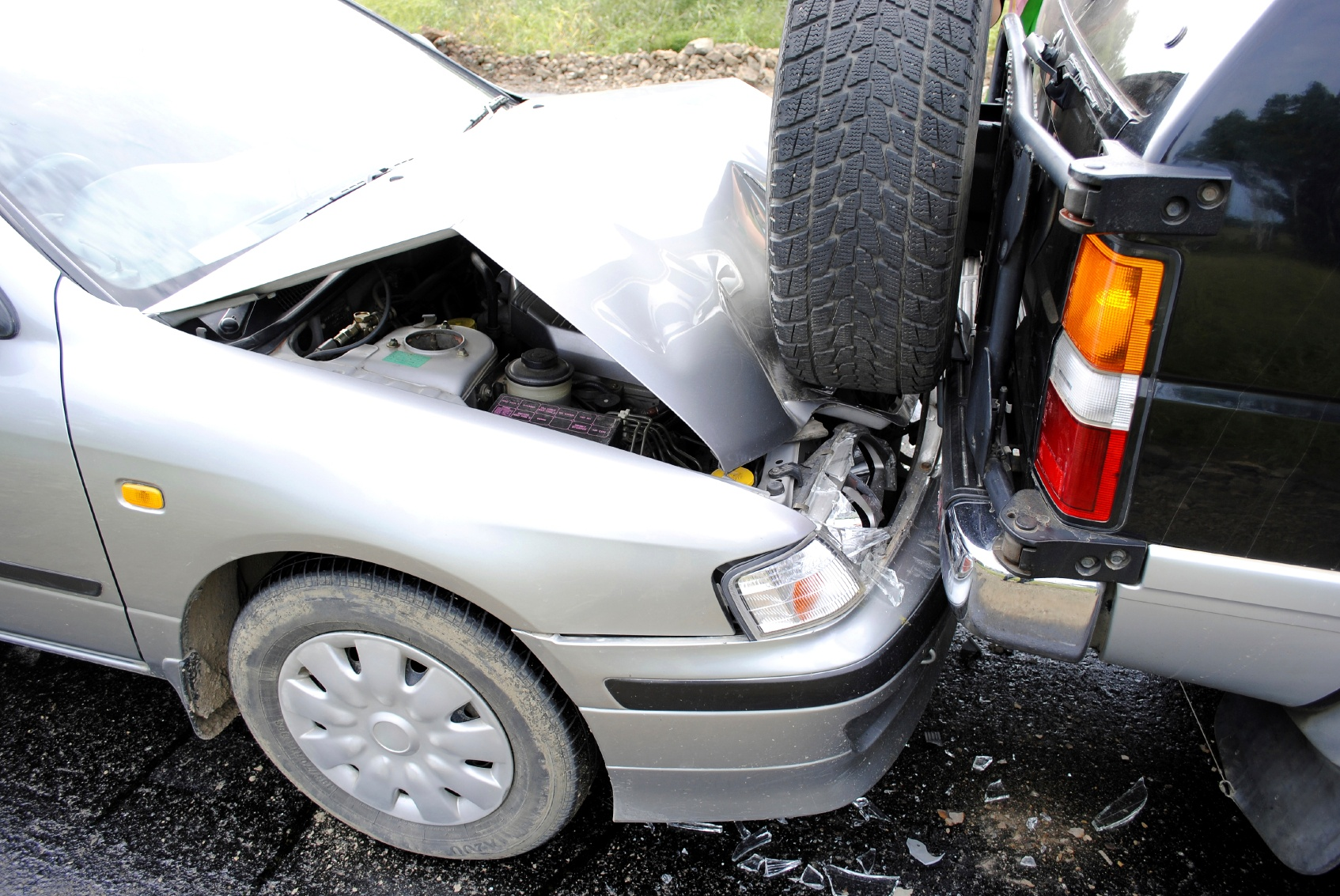 Car hit from behind causing damage and injuries